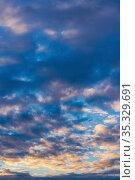 Beautiful clouds in blue sky, illuminated by rays of sun at colorful sunset to change weather. Abstract meteorology background. Стоковое фото, фотограф А. А. Пирагис / Фотобанк Лори