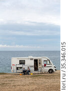 Croatia, Prementura - German tourists with their camper, nature reserve Cape Kamenjak, at the southern tip of Istria (2016 год). Редакционное фото, агентство Caro Photoagency / Фотобанк Лори