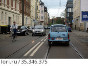 Magdeburg, Germany, blue Trabant driving on a street (2020 год). Редакционное фото, агентство Caro Photoagency / Фотобанк Лори