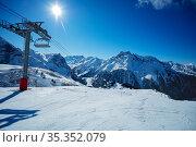 Ski lift and mountain snowy peaks in French Alps. Стоковое фото, фотограф Сергей Новиков / Фотобанк Лори