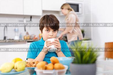 Boy having breakfast at kitchen