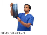 indian doctor or male nurse with x-ray. Стоковое фото, фотограф Syda Productions / Фотобанк Лори