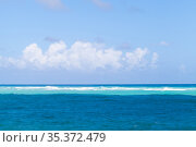 Caribbean Sea water under cloudy blue sky on a sunny day. Стоковое фото, фотограф EugeneSergeev / Фотобанк Лори