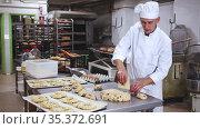 Making sweet buns and eggs in a bakery kitchen. Стоковое видео, видеограф Яков Филимонов / Фотобанк Лори