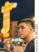 Portrait of young handsome Asian tourist man exploring at Chinatown... Стоковое фото, фотограф Zoonar.com/Toni Rantala / easy Fotostock / Фотобанк Лори