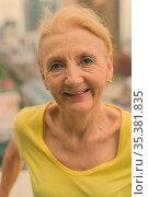 Portrait of beautiful senior woman with blond hair against view of... Стоковое фото, фотограф Zoonar.com/Toni Rantala / easy Fotostock / Фотобанк Лори