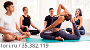 Panoramic asian yoga instructor coach wearing sportswear bra pants... Стоковое фото, фотограф Zoonar.com/Vichie81 / easy Fotostock / Фотобанк Лори