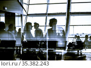 Silhouettes of business people traveling on airport waiting at the... Стоковое фото, фотограф Zoonar.com/Matej Kastelic / easy Fotostock / Фотобанк Лори