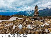 Stone cairn in Himalayas. Near Manali, above Kullu Valley, Himachal... Стоковое фото, фотограф Zoonar.com/Dmitry Rukhlenko / easy Fotostock / Фотобанк Лори