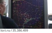 10-02-2021 KAZAN, RUSSIA, Kazan International Airport: navigation control room in the airport - a monitor with fly paths placed on the map. Редакционное видео, видеограф Константин Шишкин / Фотобанк Лори