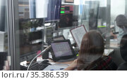 Navigation control room in the airport - a woman working with a monitor with fly paths placed on the map. Стоковое видео, видеограф Константин Шишкин / Фотобанк Лори