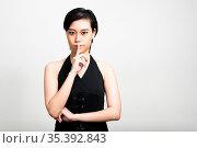 Studio shot of young beautiful Asian woman with short hair against... Стоковое фото, фотограф Zoonar.com/Toni Rantala / easy Fotostock / Фотобанк Лори