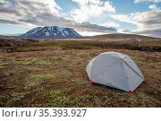Tent in Icelandic nature with snow covered hill and blue sky with... Стоковое фото, фотограф Zoonar.com/Jakub Mrocek / easy Fotostock / Фотобанк Лори