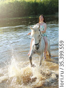 Young girl on a white horse in the lake. Стоковое фото, фотограф Филатова Ирина / Фотобанк Лори