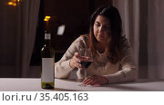 woman alcoholic drinking red wine at home at night. Стоковое видео, видеограф Syda Productions / Фотобанк Лори