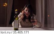 woman alcoholic drinking wine and calling on phone. Стоковое видео, видеограф Syda Productions / Фотобанк Лори