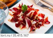 Delicious spanish dish - dried duck meat. Стоковое фото, фотограф Яков Филимонов / Фотобанк Лори