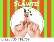 Slainte text with fingers with st patrick's day decorations. Стоковое фото, агентство Wavebreak Media / Фотобанк Лори