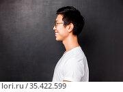 Profile portrait of happy smiling asian man in white t-shirt looking... Стоковое фото, фотограф Zoonar.com/Seva Levitsky / easy Fotostock / Фотобанк Лори