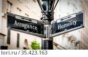 Street Sign the Direction Way to Humility versus Arrogance. Стоковое фото, фотограф Zoonar.com/Thomas Reimer / easy Fotostock / Фотобанк Лори