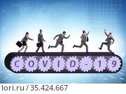 Concept of conveyor belt with covid-19 and businessman. Стоковое фото, фотограф Elnur / Фотобанк Лори