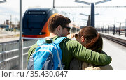 happy couple with backpacks traveling by train. Стоковое фото, фотограф Syda Productions / Фотобанк Лори