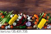 Mushrooms, vegetables, herbs on wooden surface. Стоковое фото, фотограф Яков Филимонов / Фотобанк Лори