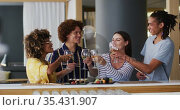Diverse group of happy friends raising glasses making a toast at a bar. Стоковое видео, агентство Wavebreak Media / Фотобанк Лори