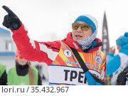 Trainer of South Korea biathlon team instructs biathletes at shooting range of biathlon stadium during Junior biathlon competitions East of Cup (2019 год). Редакционное фото, фотограф А. А. Пирагис / Фотобанк Лори