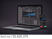Stock exchange market concept. lLaptop and smartphone with stock trader application, graphs and diagrams on screen. Стоковое фото, фотограф Maksym Yemelyanov / Фотобанк Лори