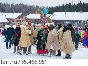 Vologda, Russia - March 13, 2021: Holiday of Shrovetide in Russia. Holiday of Shrovetide in Russia. Редакционное фото, фотограф Дмитрий Бачтуб / Фотобанк Лори