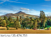 View of Old Long Hill in Wicklow Mountains from Powerscourt park,... Стоковое фото, фотограф Zoonar.com/Boris Breytman / easy Fotostock / Фотобанк Лори