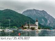Schloss Ort is an Austrian castle situated in the Traunsee lake, in... Стоковое фото, фотограф Zoonar.com/Boris Breytman / easy Fotostock / Фотобанк Лори