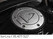 Ducati motorcycle details, metallic gray fuel cap (2019 год). Редакционное фото, фотограф EugeneSergeev / Фотобанк Лори