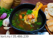 Delicious soup with chicken, bacon, leek and vegetables served in bowl. Стоковое фото, фотограф Яков Филимонов / Фотобанк Лори
