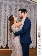 Couple dancing gentle sensual dance indoor. Стоковое фото, фотограф Евгений Харитонов / Фотобанк Лори