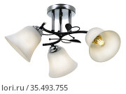 Black 3-lamp ceiling lamp with chrome base and matt white bell-shaped shades. Isolated on white background. Стоковое фото, фотограф Вадим Орлов / Фотобанк Лори