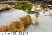 Travertine terraces with hot water of Karahyit Red Springs, Turkey. Стоковое фото, фотограф Яков Филимонов / Фотобанк Лори