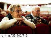 Elderly woman enjoying performance at opera and ballet theater. Стоковое фото, фотограф Татьяна Яцевич / Фотобанк Лори
