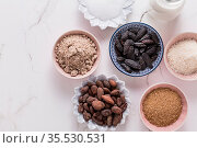 Assortment of flagrant baking ingredients, tonka and cocoa beans,... Стоковое фото, фотограф Zoonar.com/Ingrid Balabanova / easy Fotostock / Фотобанк Лори