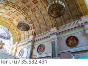Internal interior of the Belorusskiy railway station (written in Russian)-- is one of the nine main railway stations in Moscow, Russia. It was opened in 1870 and rebuilt in its current form in 1907-1912 (2015 год). Редакционное фото, фотограф Владимир Журавлев / Фотобанк Лори
