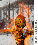 Румяное чучело масленицы объято ярким пламенем. Прощание с зимой. Стоковое фото, фотограф Наталья Николаева / Фотобанк Лори
