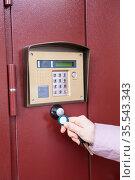 The hand applying RFID key to the intercom. Woman hand close up view. Стоковое фото, фотограф Кекяляйнен Андрей / Фотобанк Лори