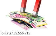 A magnet attracts euro bills. Стоковое фото, фотограф Zoonar.com/DesignIt / easy Fotostock / Фотобанк Лори
