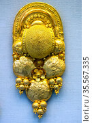 Gold earing made of thin sheet decorated with bosses, globule clusters... Стоковое фото, фотограф Stefano Ravera / age Fotostock / Фотобанк Лори
