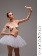 Attractive young slim female in ballet tutu skirt and with sticky... Стоковое фото, фотограф Zoonar.com/Andrey Guryanov / easy Fotostock / Фотобанк Лори