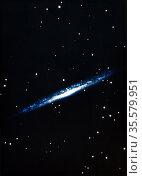 Spiral galaxy viewed edge on. US Naval Observatory. Редакционное фото, агентство World History Archive / Фотобанк Лори