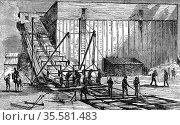 Steam-powered ice elevator for raising blocks of ice from the river... Редакционное фото, агентство World History Archive / Фотобанк Лори