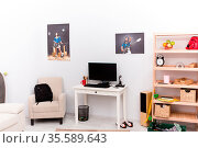 Cropped picture of teenager room. White room of young teenager boy, Стоковое фото, фотограф Zoonar.com/Svyatoslav Lypynskyy / easy Fotostock / Фотобанк Лори
