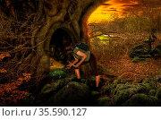 Girl in fairy forest found the secret entrance to the dungeon. Стоковое фото, фотограф Zoonar.com/Dmitriy Sladkov / easy Fotostock / Фотобанк Лори